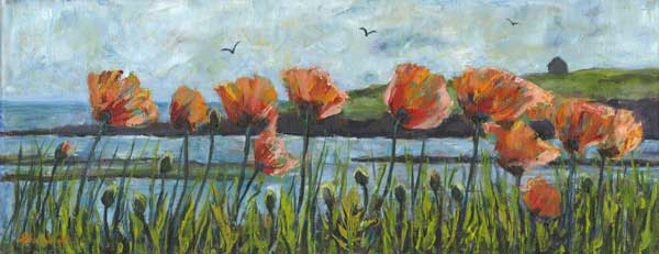 Poppies in grass beside the sea